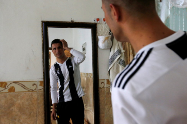 [Photos] Cristiano Ronaldo Look-Alike :Biwar Abdullah Gets Treated Like A Star