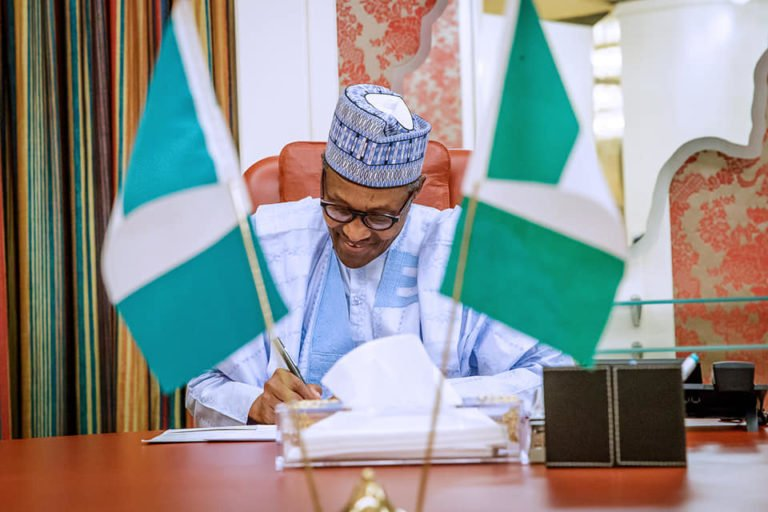 I expect more commitment from workers – president Buhari says as he signs N30k minimum wage bill.